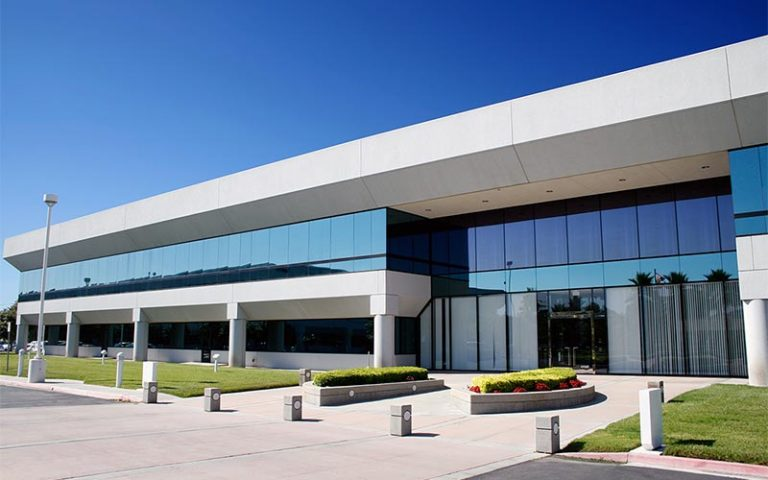 2 story modern office complex exterior on a clear day
