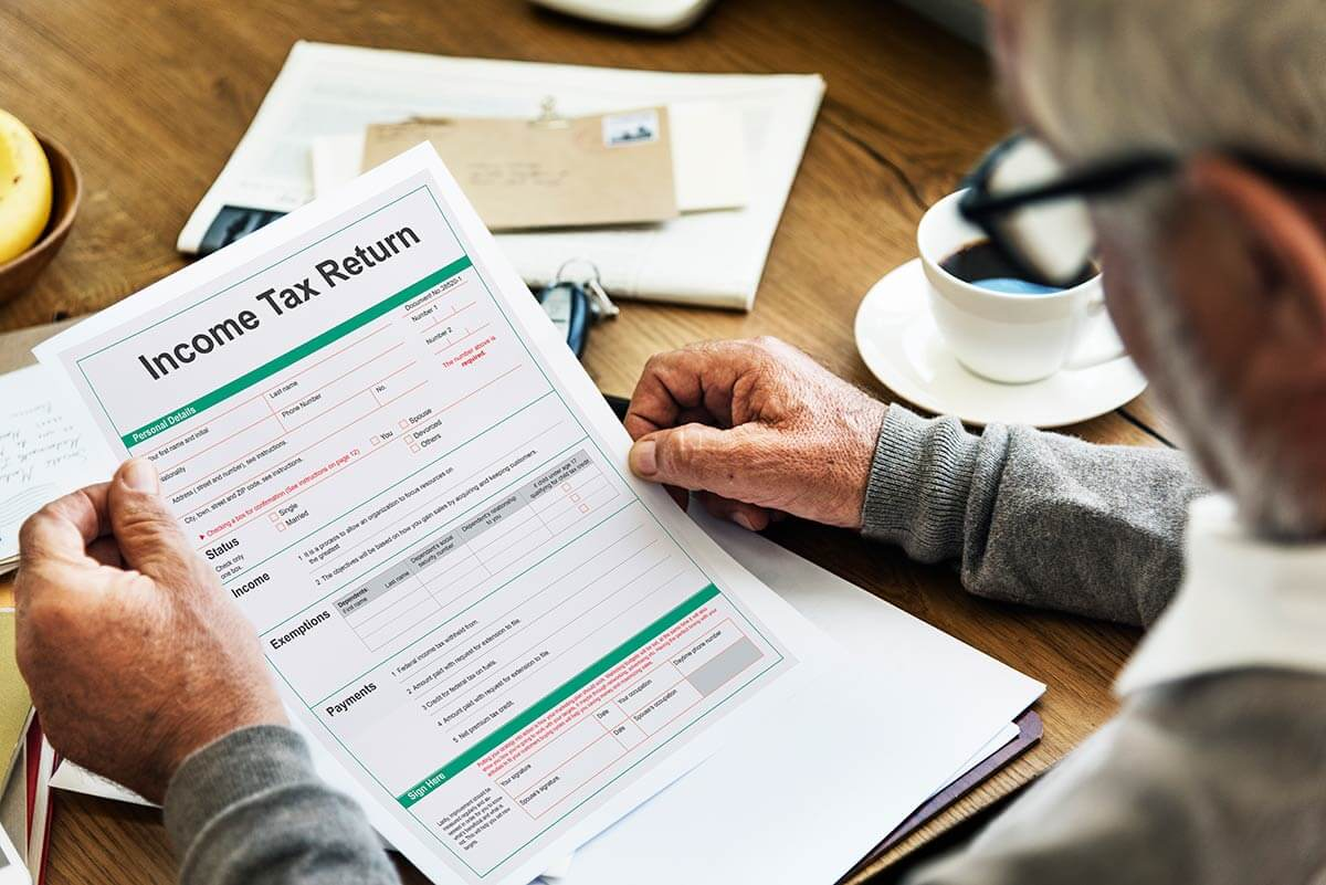 Older man looking at income tax returns