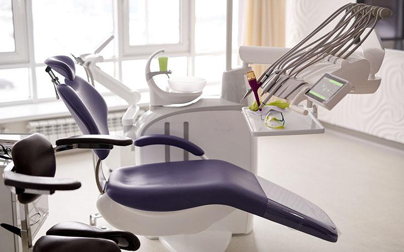 Dentist chair inside of a dentist office