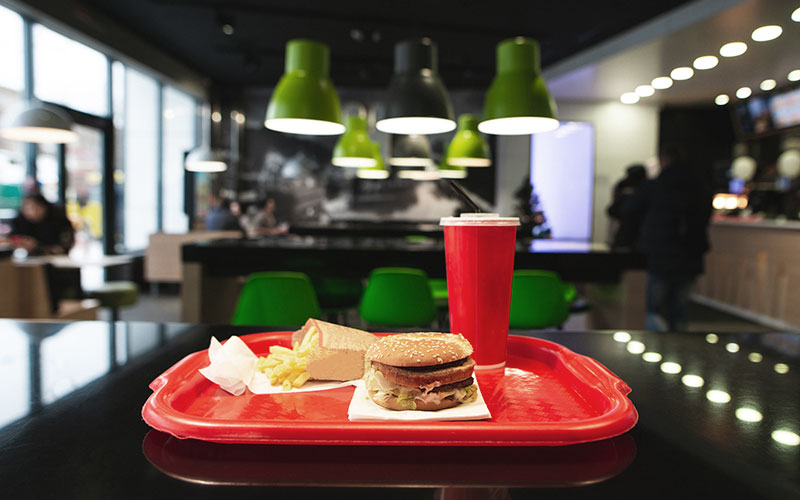 Fast food on a tray inside of a restaurant