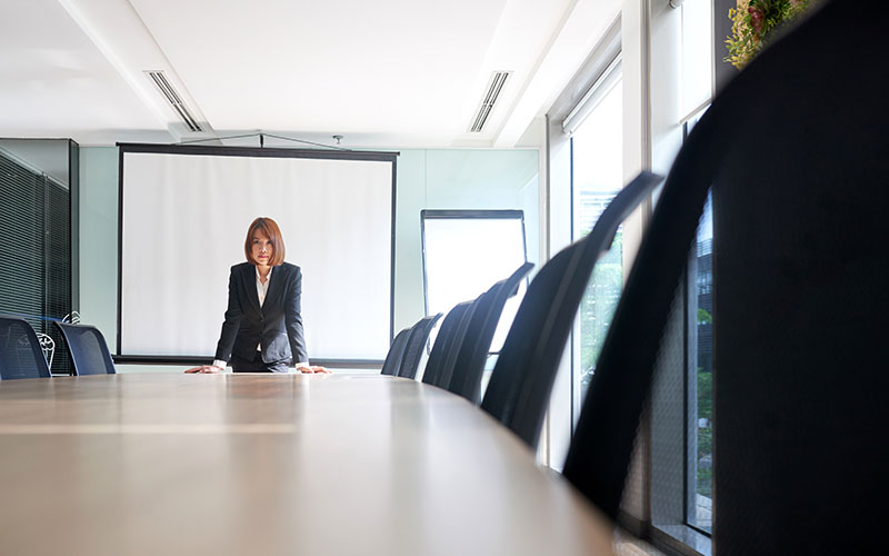 Lone businesswoman in a conference room