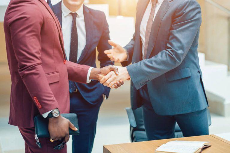 Men shaking hands in partnership