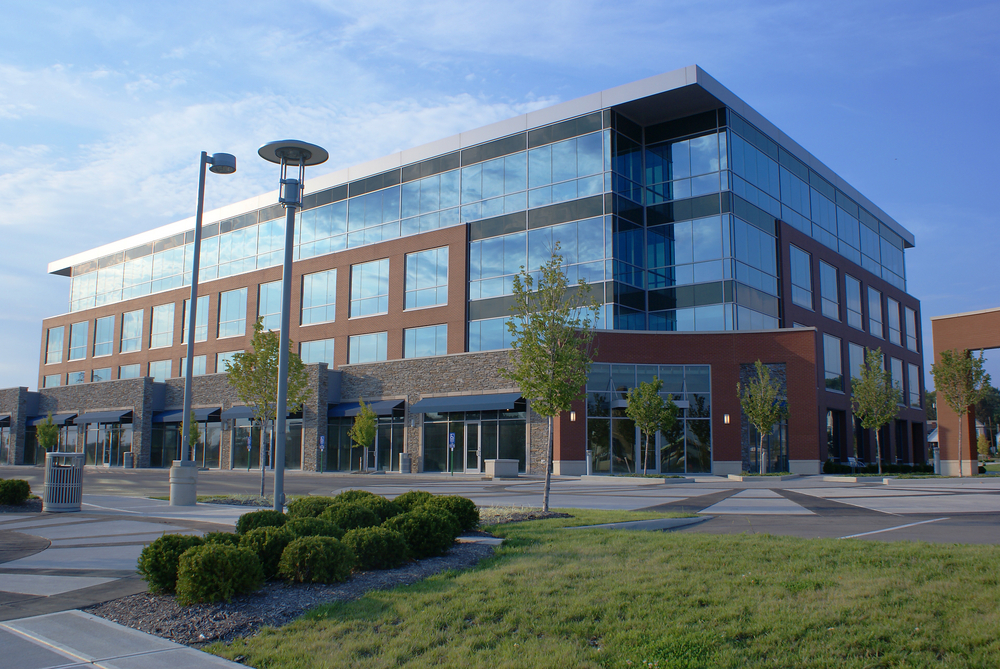 Wide shot of a large office building with many windows