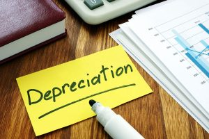 Sticky note with the word depreciation written in marker