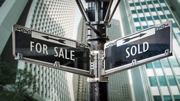 "Street signs with the words ""For Sale"" and ""Sold"""